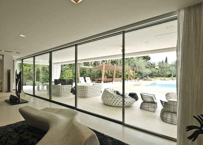 Infissi in alluminio prezzi vantaggi e caratteristiche for Vetrate case moderne